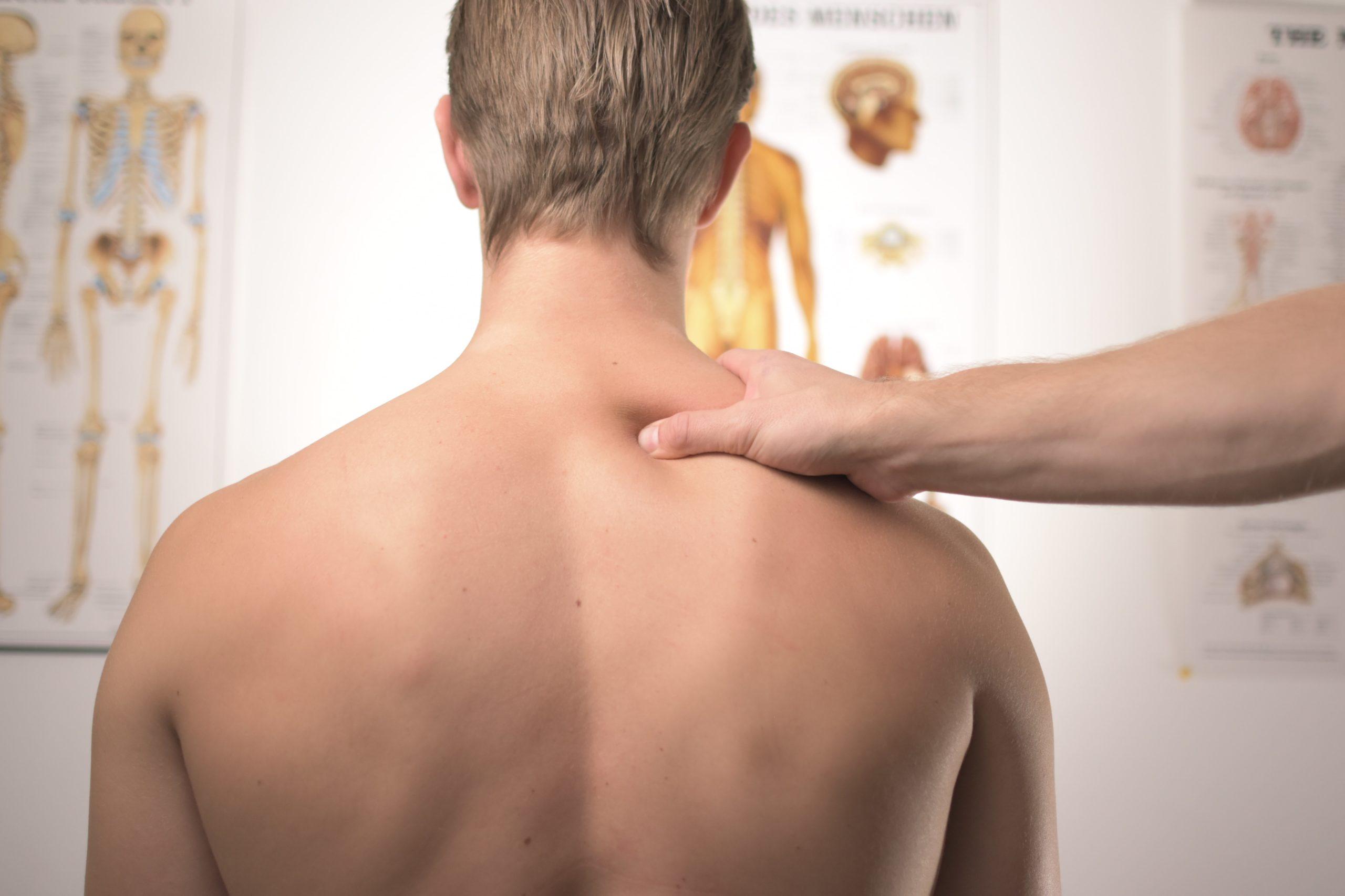 man's shoulders in doctor's office