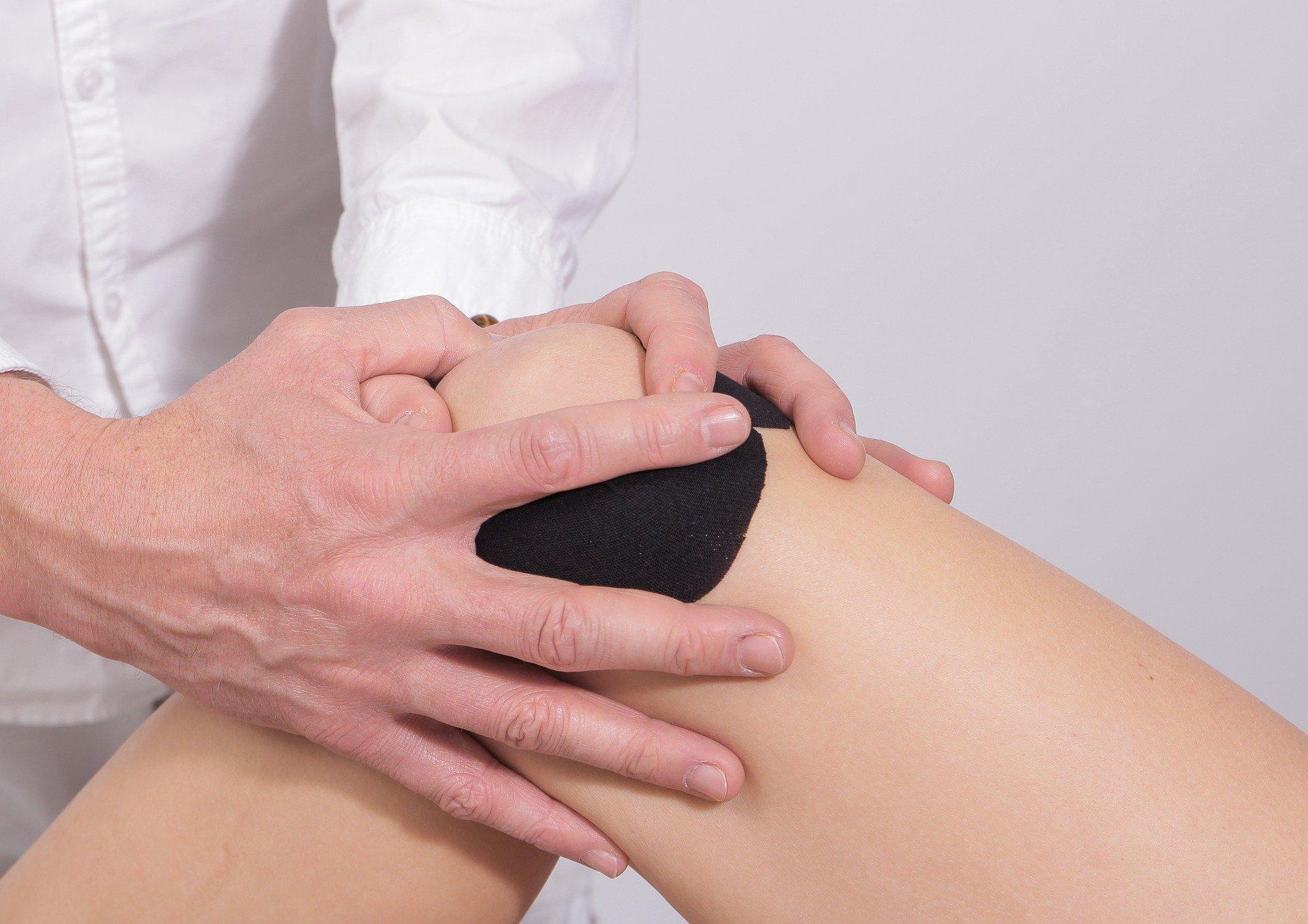 doctor tending to a knee patient